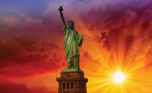 Fototapet med motivet: New York Statue Liberty Solnedgång